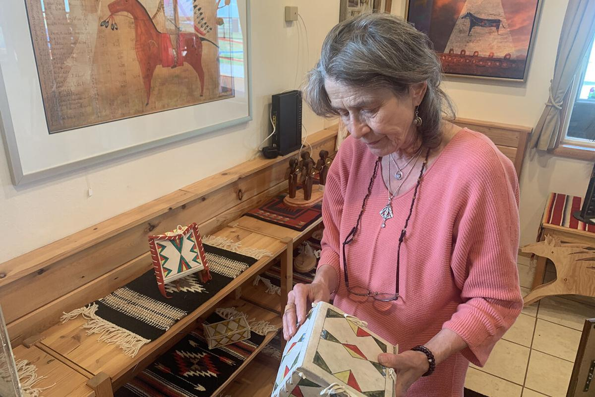 Angelika Harden-Norman holds a parfleche box made by her late husband, Darrell Norman. Harden-Norman made both traditional and modern Blackfeet artwork. They were used by Native Americans to carry items as they traveled.