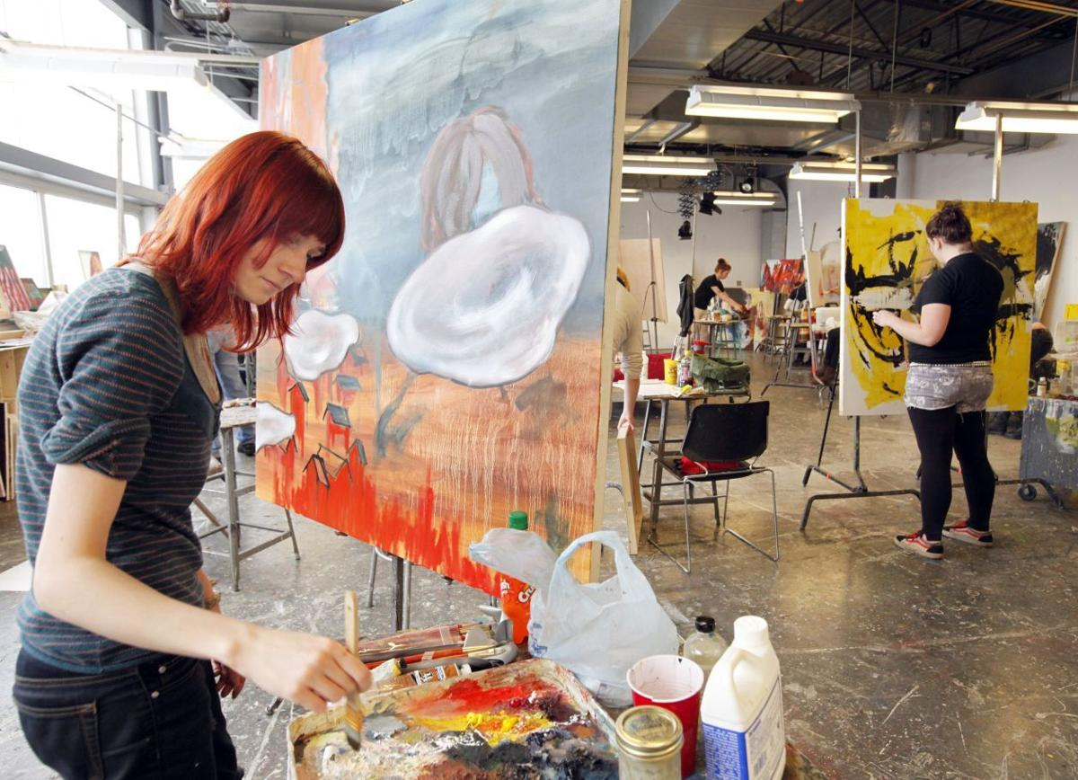 Jesse schwetke 22 a senior art student from faquier county works on her oil on canvas in the advanced painting class at vcu school of the arts at right