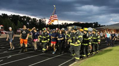 Powhatan's Russ Holland runs to honor 9/11 firefighters