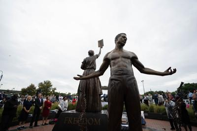 Monument honoring abolition of slavery unveiled in Richmond two weeks after Robert E. Lee statue was removed