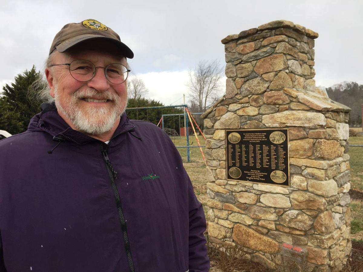 Bill Henry and the monument in Madison County