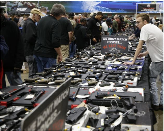 People browsed tables full of handguns at Richmond Raceway