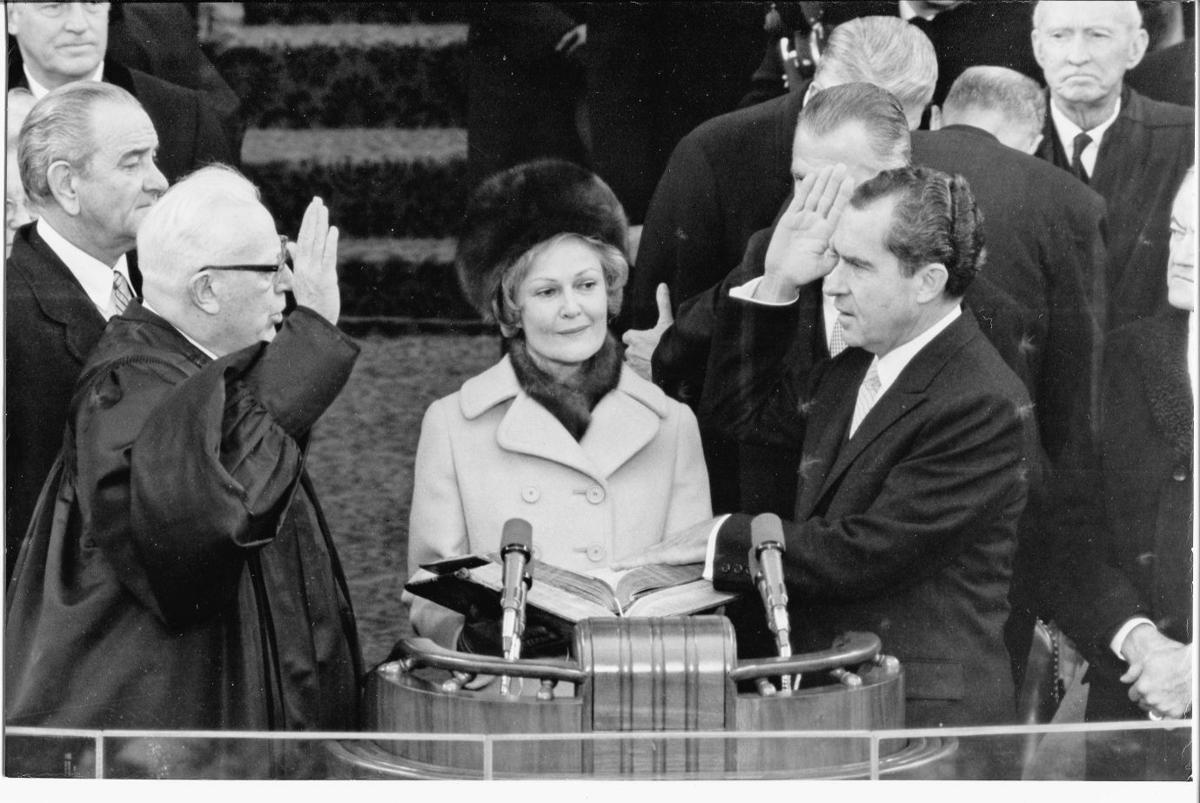 nixon office. 20, 1969, Richard Nixon Took The Oath Of Office For His First Term As President. Administering Is Chief Justice Earl Warren; Holding A Family Bible