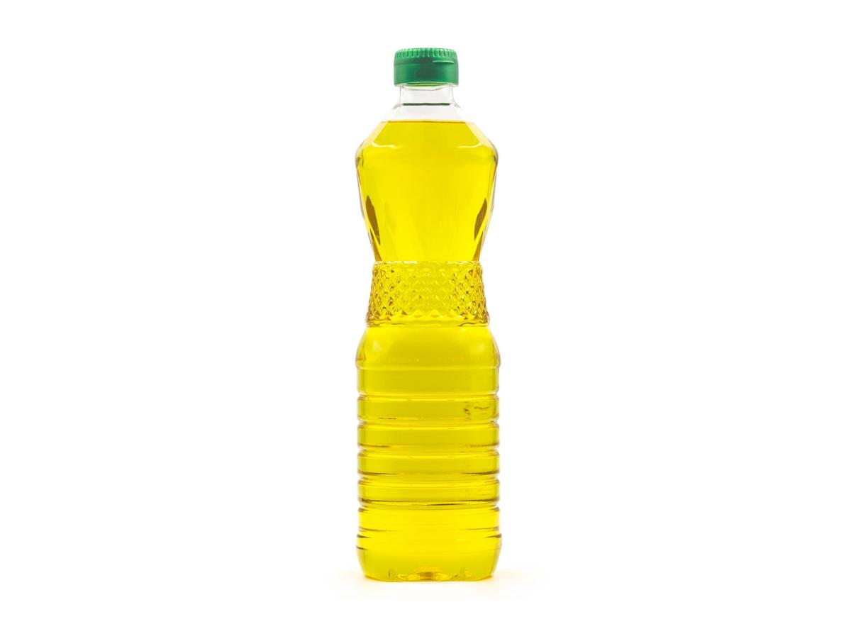 Plastic bottle of palm or vegetable cooking oil isolated on white background with clipping path