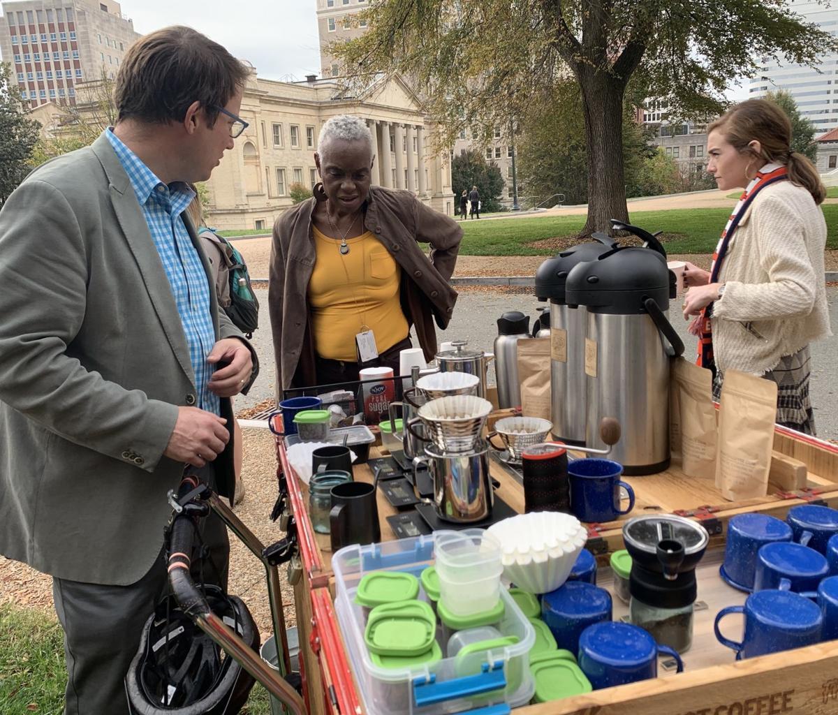 John Freyer serving coffee