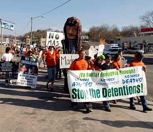 Protest against immigrant detention center draws 150 in Farmville