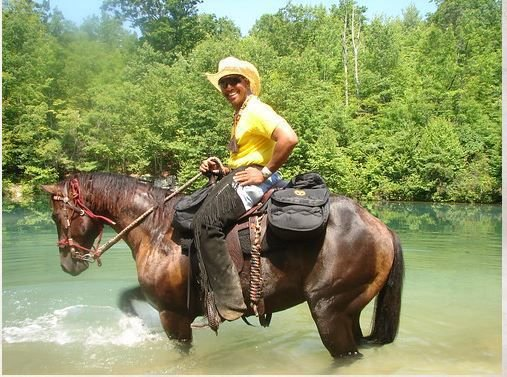 Nathaniel Whitefeather riding one of his horses