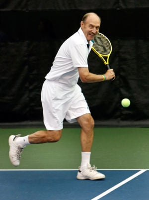 Stan Smith gives tennis lessons to