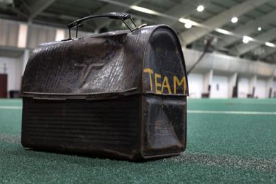 Lunch pail on turf (copy)