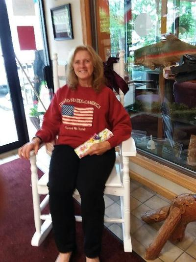 Cindy Cortinovis of St. Marys announced as the winner of the Women in our Lives raffle sponsored by the Ridgway Record and the Ridgway-Elk County Chamber of Commerce on Friday. The prize included a beautiful rocking chair, donated by Tractor Supply St. Marys, an alpaca throw donated by Elk County Commissioner Fritz Lecker, a box of chocolates from Dan Smith's Candy in Ridgway, a Boston Fern from Elk County Foods of Ridgway and Johnsonburg and a 1-year subscription to the Ridgway Record/Daily Press.