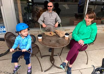 Family sits outside Mugs Coffeehouse