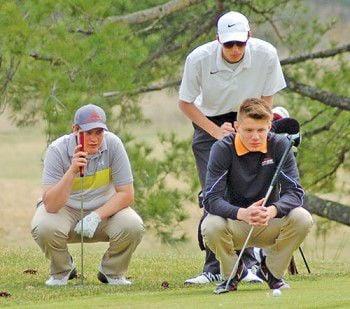 Golfers improve scores in home match