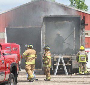 Fire damages warehouse, trailer near Green Lake