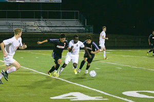 Offensive outburst kicks Tiger soccer squad into playoffs