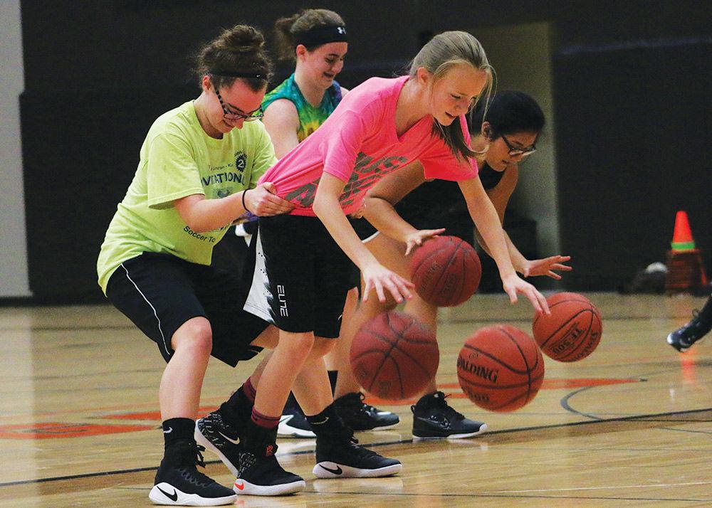 Dribbling toward success: Girls' basketball begins practice