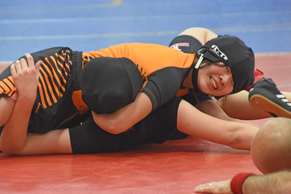 Girl grappler has pin-terest in wrestling