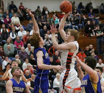 Tigers cruise past Cougars 62-32; Laconia up next