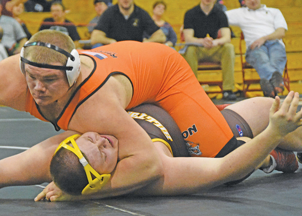 State bound: Tigers qualify record five grapplers to Madison