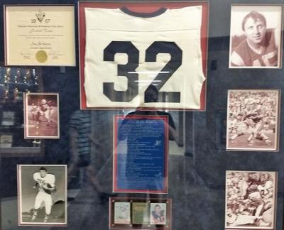 Jim Bertelsen's retired No. 32 Hudson jersey hangs in the hallway outside the high school gymnasium.