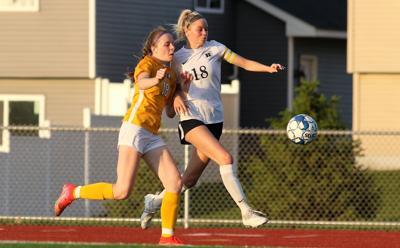 River Falls' Kraly Walker defends Hudson's Stella Duffee