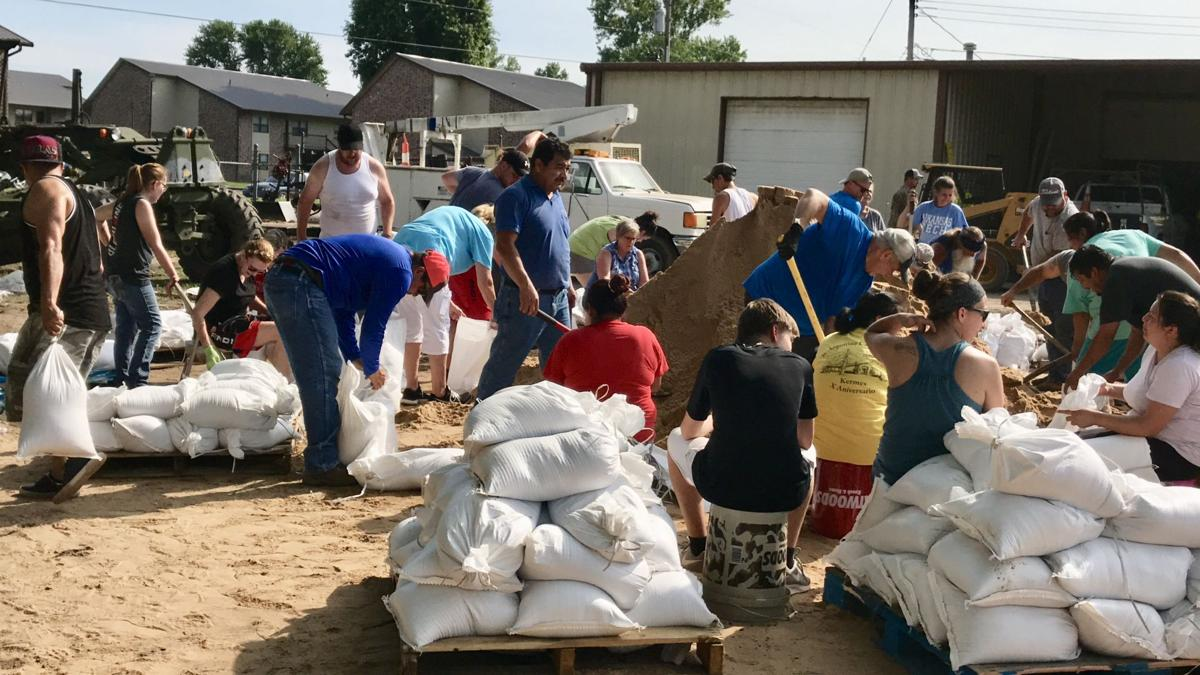 Yell County residents join together against rising flood waters