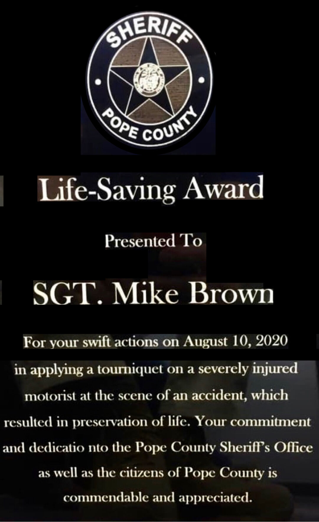 Pope County Sheriff's Office Sergeant Mike Brown presented Life Saving Award