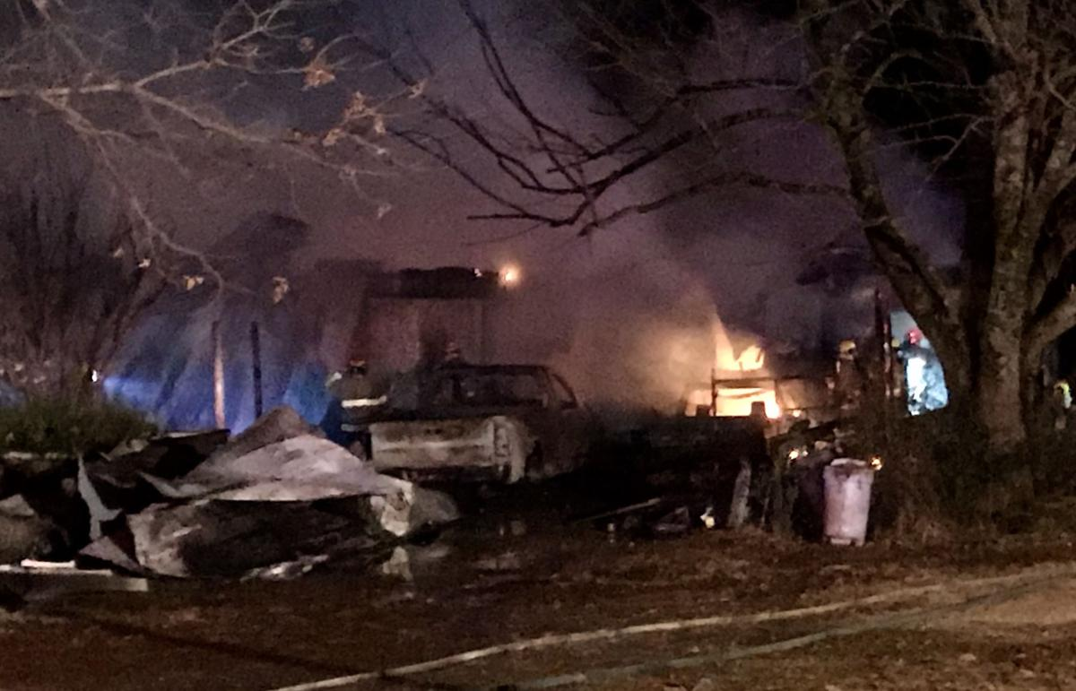 Fire destroys home and two vehicles on State Highway 105 North