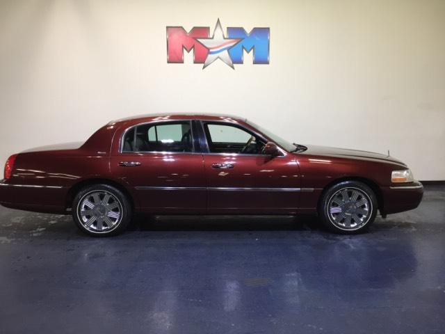 Autumn Red Metallic Lincoln Town Car