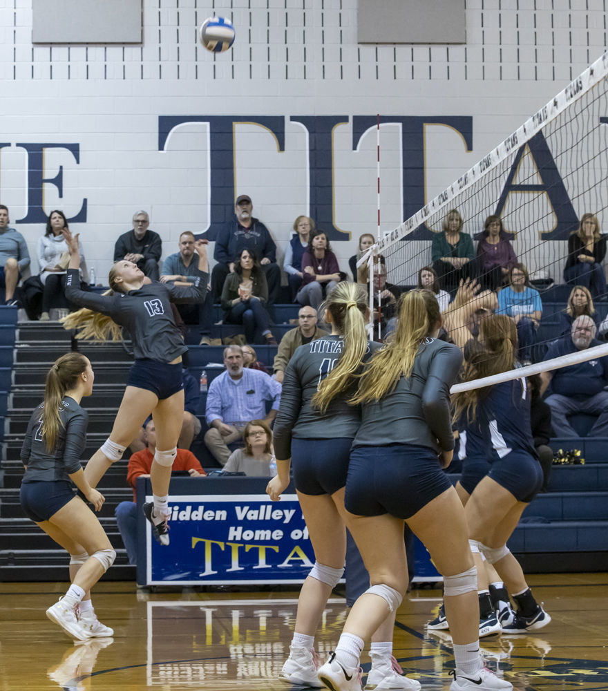 Hidden Valley's (13) Cam Davenport goes up for the spike as teammates (2) Claire Nichols, (10) Faith Mitchell and (4) Abigail Atkins look on.
