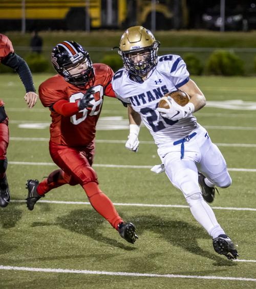 Hidden Valley's (20) Matt Strong turns the corner as Cave Spring's (88) Nathan Chapman tries to  chases him down.