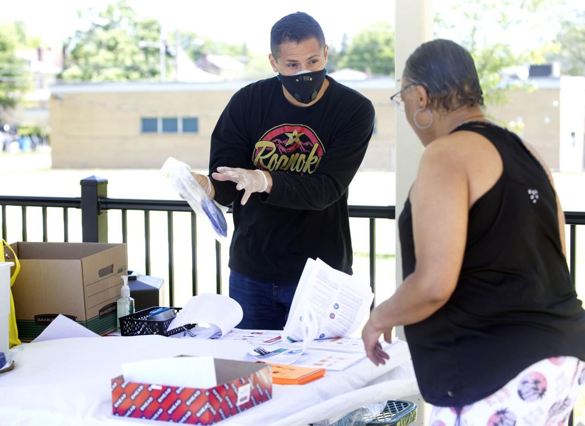 Del. Sam Rasoul, D-Roanoke, distributes masks