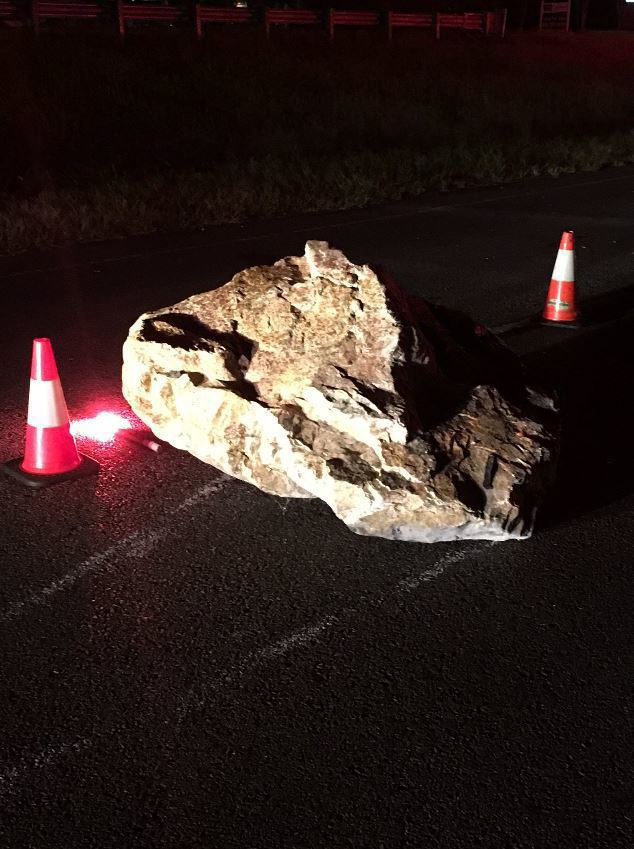 Large boulder causes traffic wreck