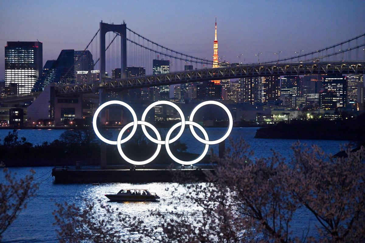 A boat sails past the 2020 Olympic Rings on March 25, 2020, in Tokyo, Japan.