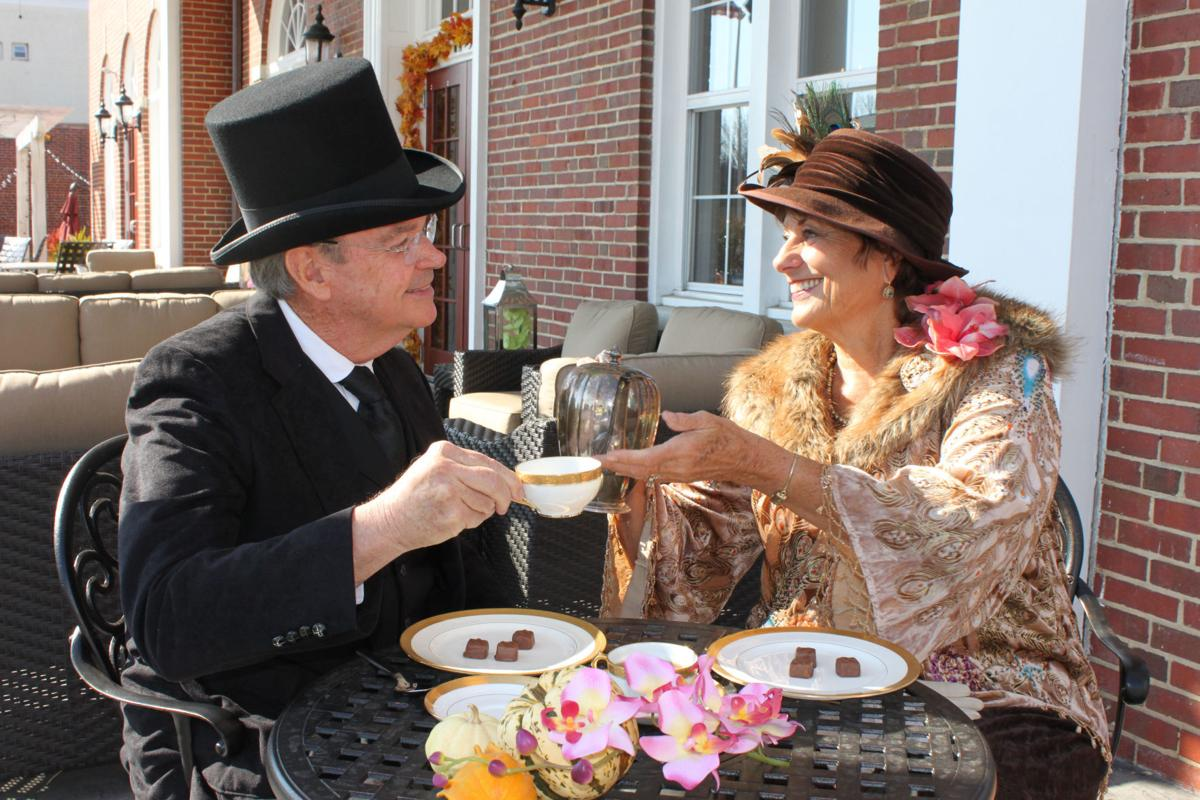 President and Mrs. Wilson, portrayed by Jim Gearhart and Betsy Ely, enjoy afternoon tea