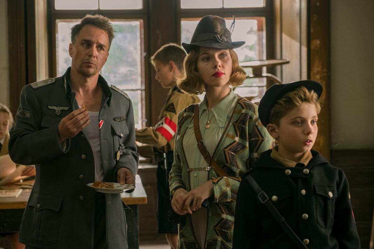 Sam Rockwell (Captain Klezendorf), Scarlet Johansson (Rosie Betzler) and Roman Griffin Davis (Jojo Betzler) in Jojo Rabbit.