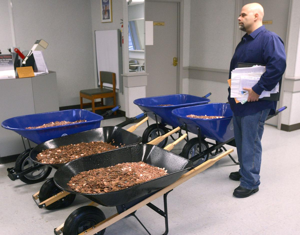 Virginia man spends $1,000 to deliver 300,000 pennies to