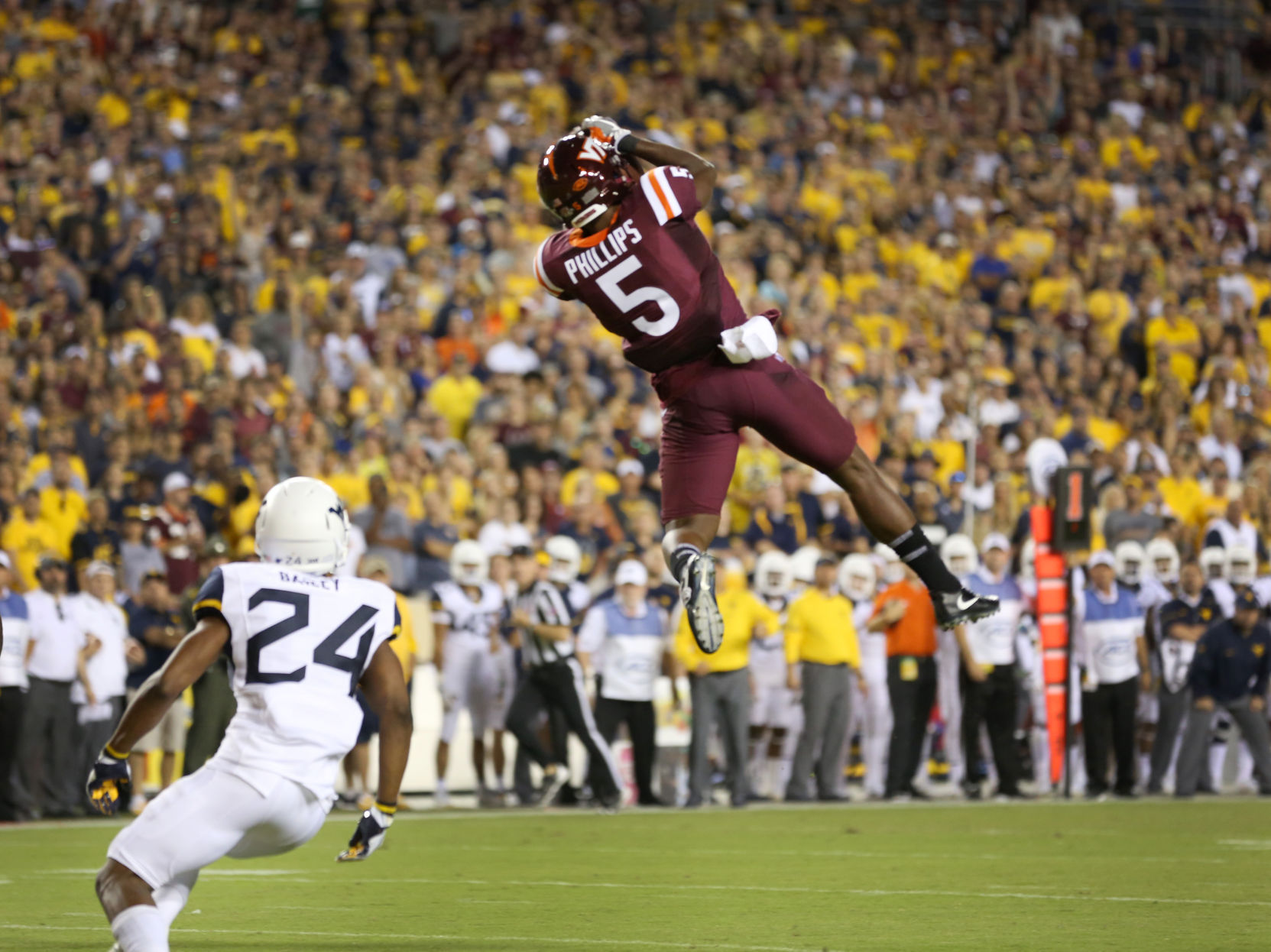 Virginia Tech holds on to beat West Virginia 31-24