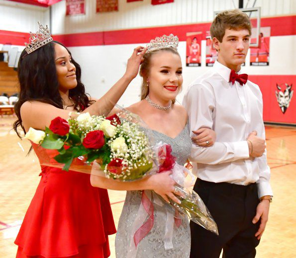 2017 Homecoming Queen, Ary Bell (left) crowns 2018 Queen, Olivia Bilyeu. Her escourt, Collin Richards, is at right. .jpg
