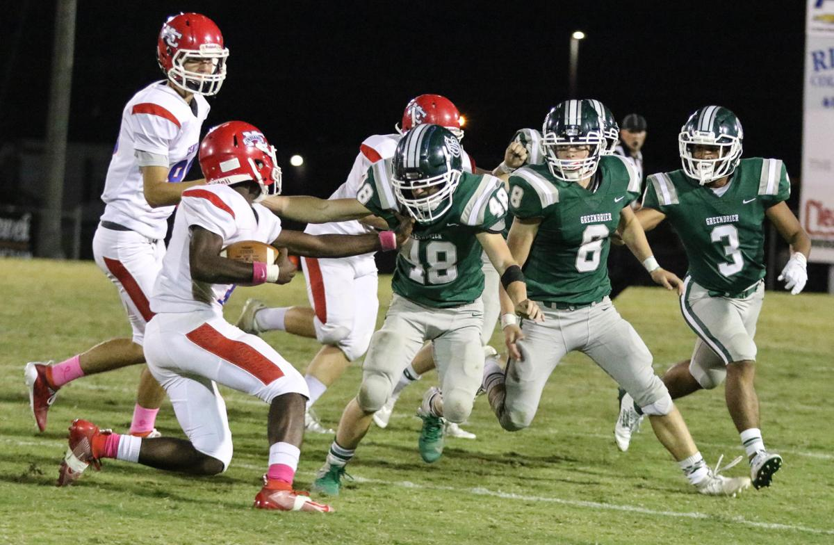 Greenbriers defensive members Reagan Conquest (48) Izik Rector (8) and Zamyrion Atkins stops the Montgomery Central runner.jpg