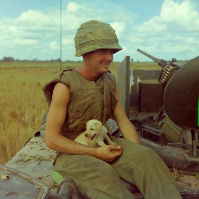 AP4 Jackie Coulter from Lafayette, GA holding a puppy that survived an earlier air strike.  Very popular photo taken by Robert Lafoon.jpg