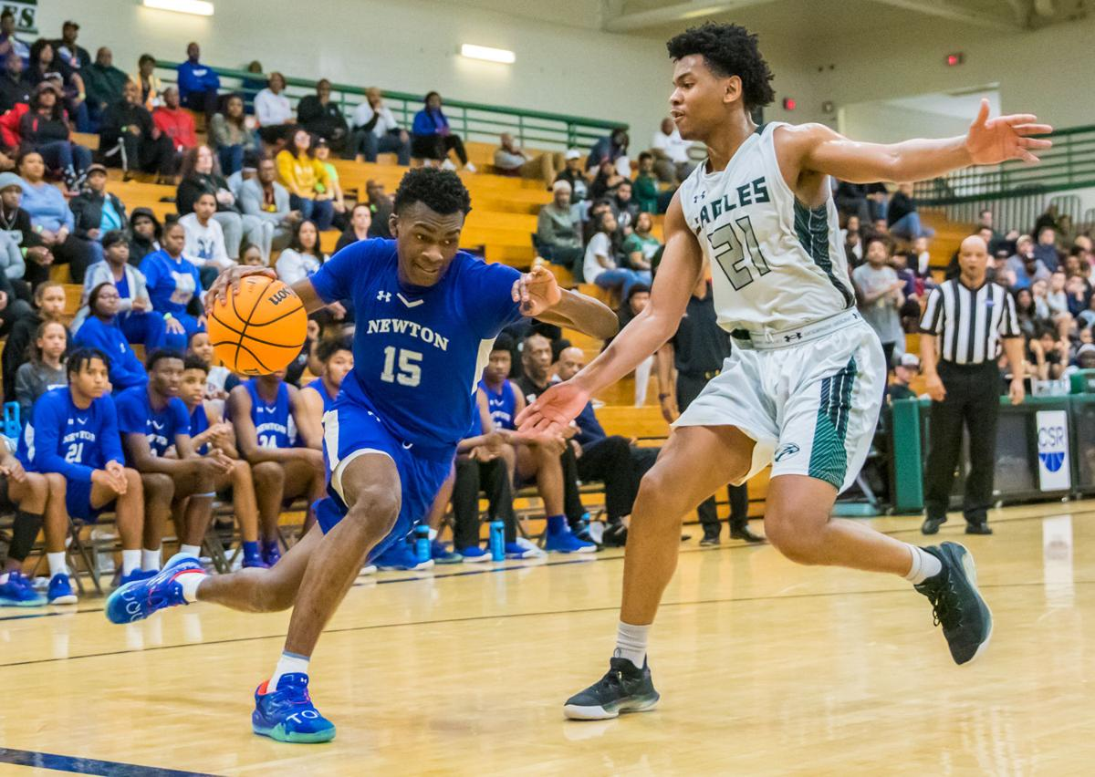 Newton's Qua Brown drives to the basket against Collins Hill