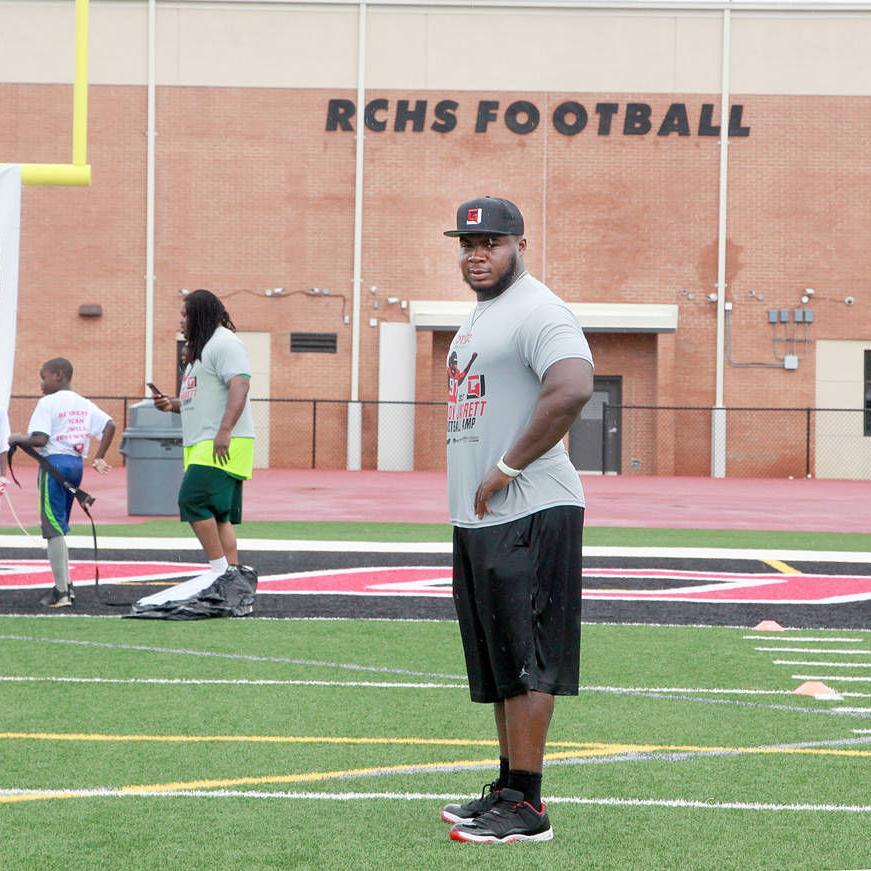 Grady Jarrett coaches at youth football camp