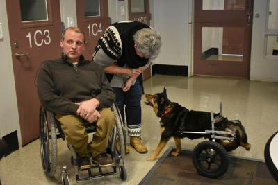 Bandit, the jail dog, gets adopted for fifth time by man also in wheelchair