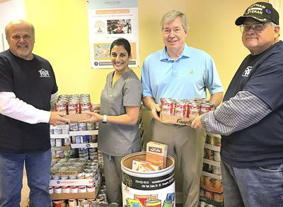 Dentists collect 700 cans of food for emergency relief