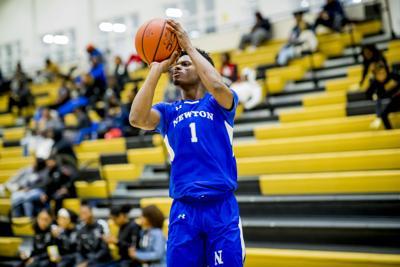 Newton's Caleb Byrd shoots a jump shot against McDonough Tuesday night