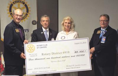 Conyers Rotary donates to Alzheimer's research
