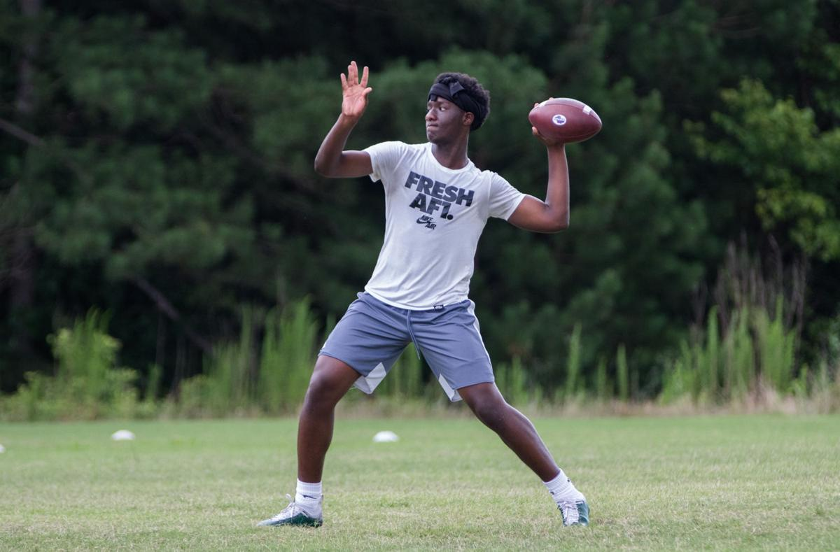Eastside rising senior quarterback Jaylen Woods throws a pass Thursday afternoon