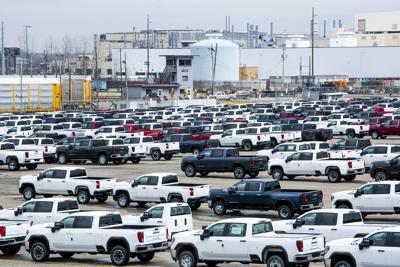 GM posts $806 million loss as pandemic dampens sales