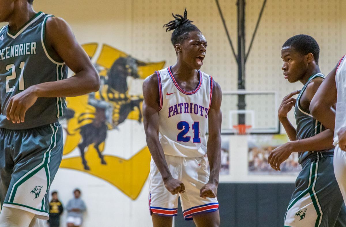 Heritage's Chase Lackey celebrates after a Courtney McBride made basket