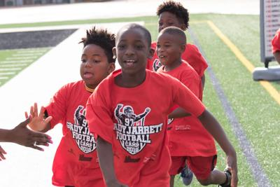 Rockdale alum Grady Jarrett wrapped up his third successful youth football camp Friday